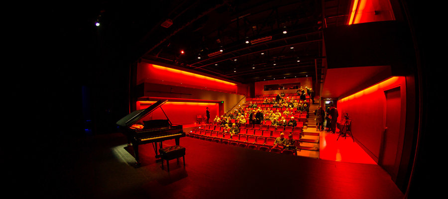 Piano in red theatre Slider Image